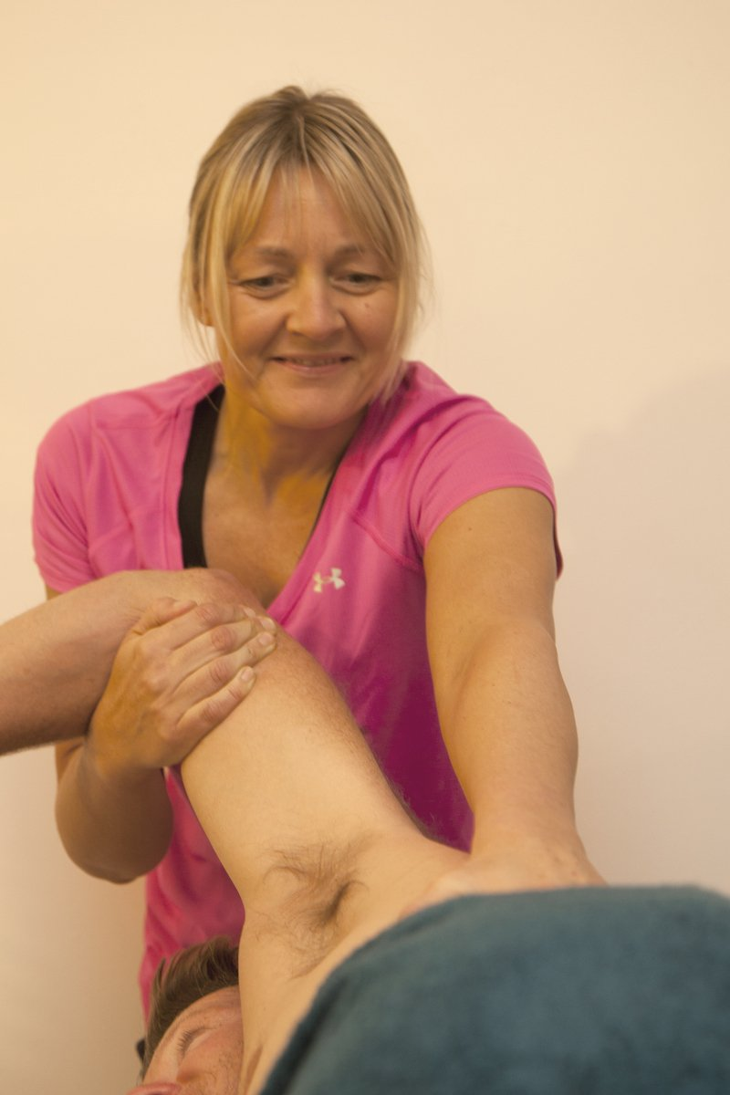 Katie performing a soft tissue therapy massage
