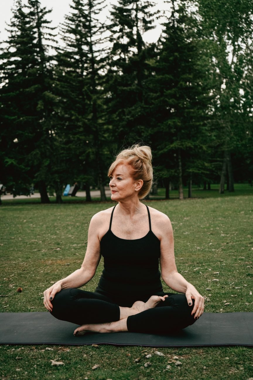 A lady over 50 doing a yoga position